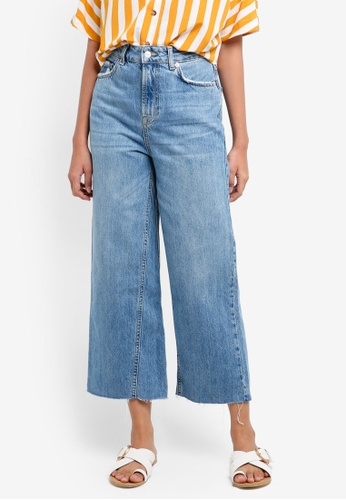 ecd7cf8833ac Buy TOPSHOP Moto Mid Blue Cropped Wide Leg Jeans Online on ZALORA ...