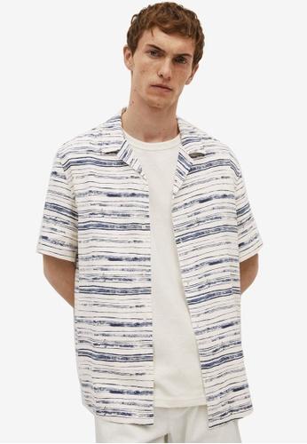 MANGO Man beige Printed Flowy Shirt 16F7FAA02D73CFGS_1