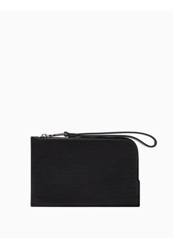 Calvin Klein black Debossed Logo Mini Wristlet 67CACACF167A4EGS_1