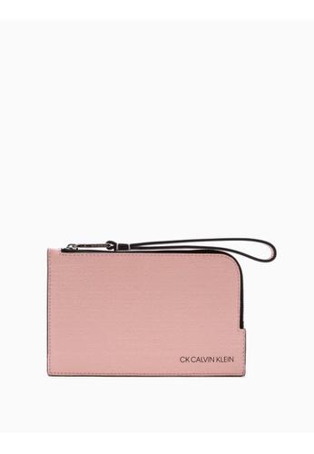 Calvin Klein pink Debossed Logo Mini Wristlet AE3CBAC9BEA4E6GS_1