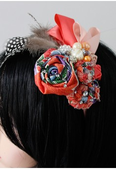 Image of Orange rose headband .