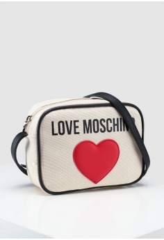 443ccc0bd6 20% OFF Love Moschino Canvas Sling Bag HK$ 1,209.00 NOW HK$ 967.00 Sizes  One Size