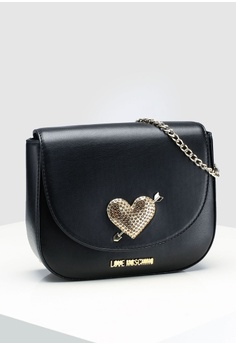 e81711cae004 Love Moschino Sling Bag With Heart Detail S  269.00. Sizes One Size