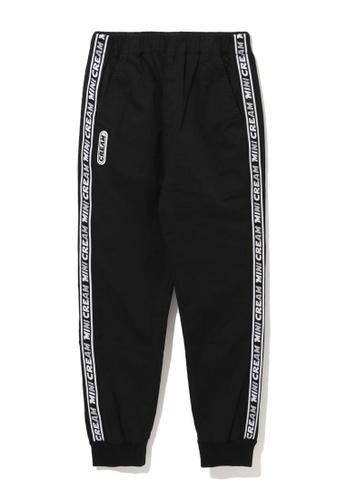 Mini cream black Logo tape slim fit pants FAB92AAE6FB08DGS_1