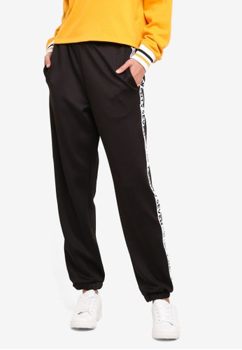 Supre black and multi Tricot Side Tape Track Pants 40D2EAAE600FEAGS_1