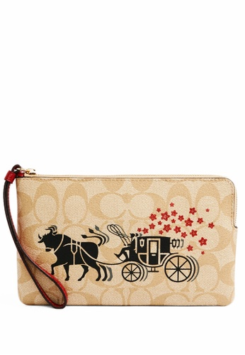 Coach multi Coach Large Corner Zip Wristlet In Signature Canvas With Ox And Carriage - Light Brown D71F8ACDB33DDCGS_1