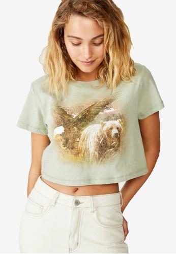 Cotton On green Cara Graphic Crop T Shirt 3E059AA47D0879GS_1