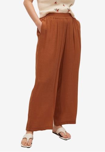 Violeta by MANGO orange Plus Size Flowy Flared Trousers 9EE6FAA591DD04GS_1