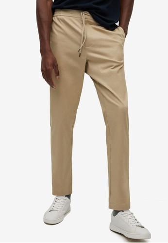 MANGO Man beige Cotton Jogger-Style Trousers 398EBAA2CC431FGS_1