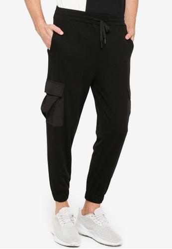 ZALORA ACTIVE black Mixed Material Jogger Pants 10412AA83E554EGS_1