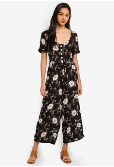 76412a9914d2 Miss Selfridge Black Floral Print V Neck Button Through Jumpsuit S  99.90.  Sizes 6 8 10 12 14