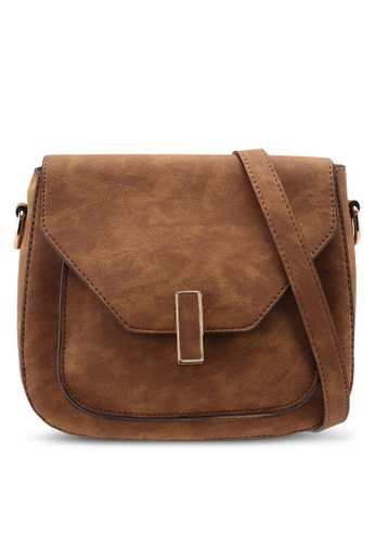 5dffa9e7517 Tan Twistlock Saddle Crossbody Bag