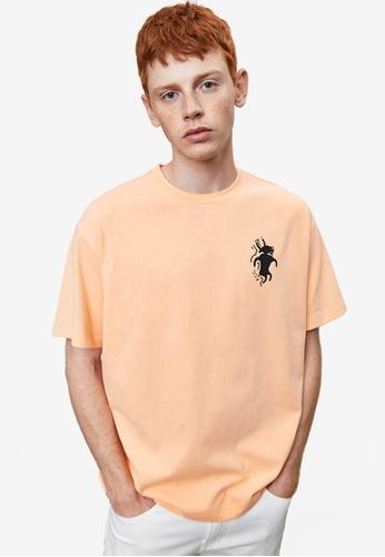 URBAN REVIVO orange Printed T-Shirt 7350AAA4DCCB31GS_1