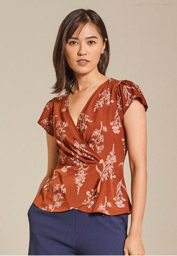 Dressing Paula orange Printed Crepe Peplum Top CB43CAAC491167GS_1