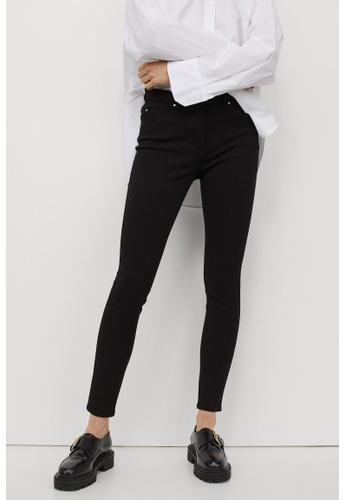 H&M black Superstretch Trousers FC56FAA4E8763EGS_1