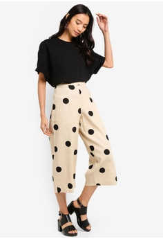 f55b2654ecfd7 TOPSHOP Petite Lulu Spot Crop Wide Trousers S  79.90. Sizes 6 10 12
