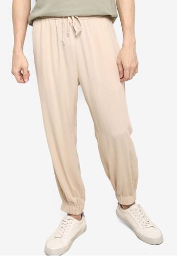 ZALORA BASICS beige Relaxed Woven Jogger Pants F4A24AA7AA6EB0GS_1